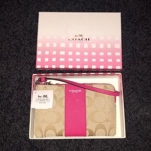 Coach wristlet. Still in box with tag